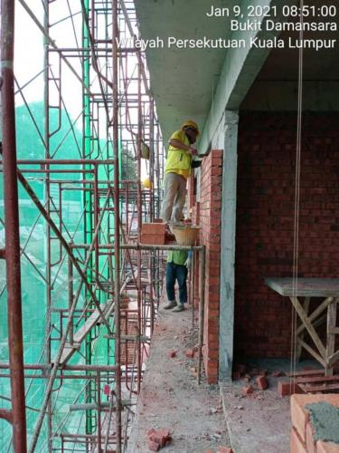 Block B - brickworks in progress with safety netting.