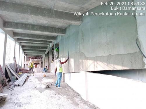 Block B - plastering to the ramp walls.